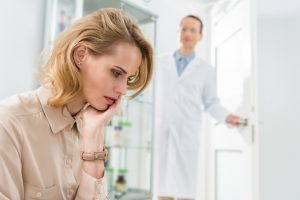 female patient with dental anxiety at the dentist's office